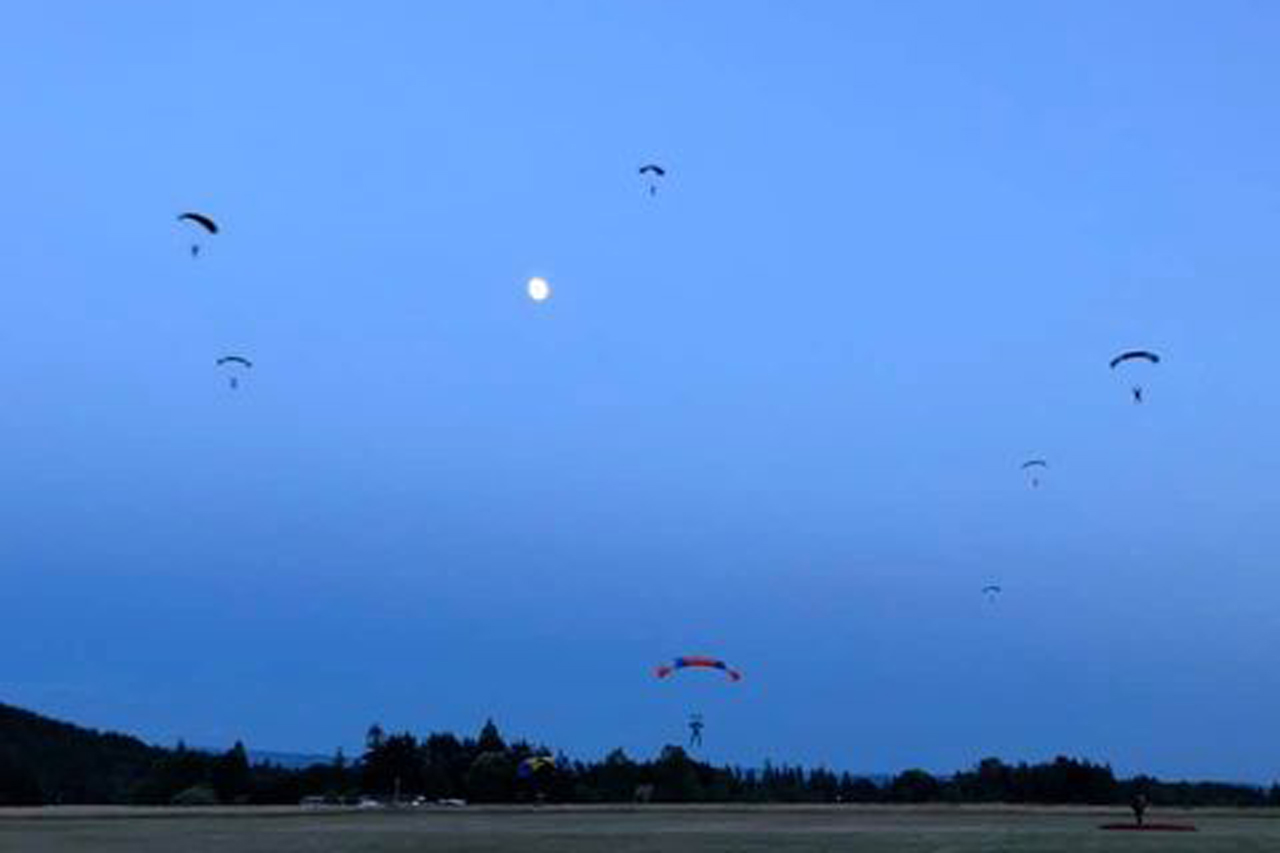Fun jumpers coming in for landing during a night jump at PNW Skydiving Center
