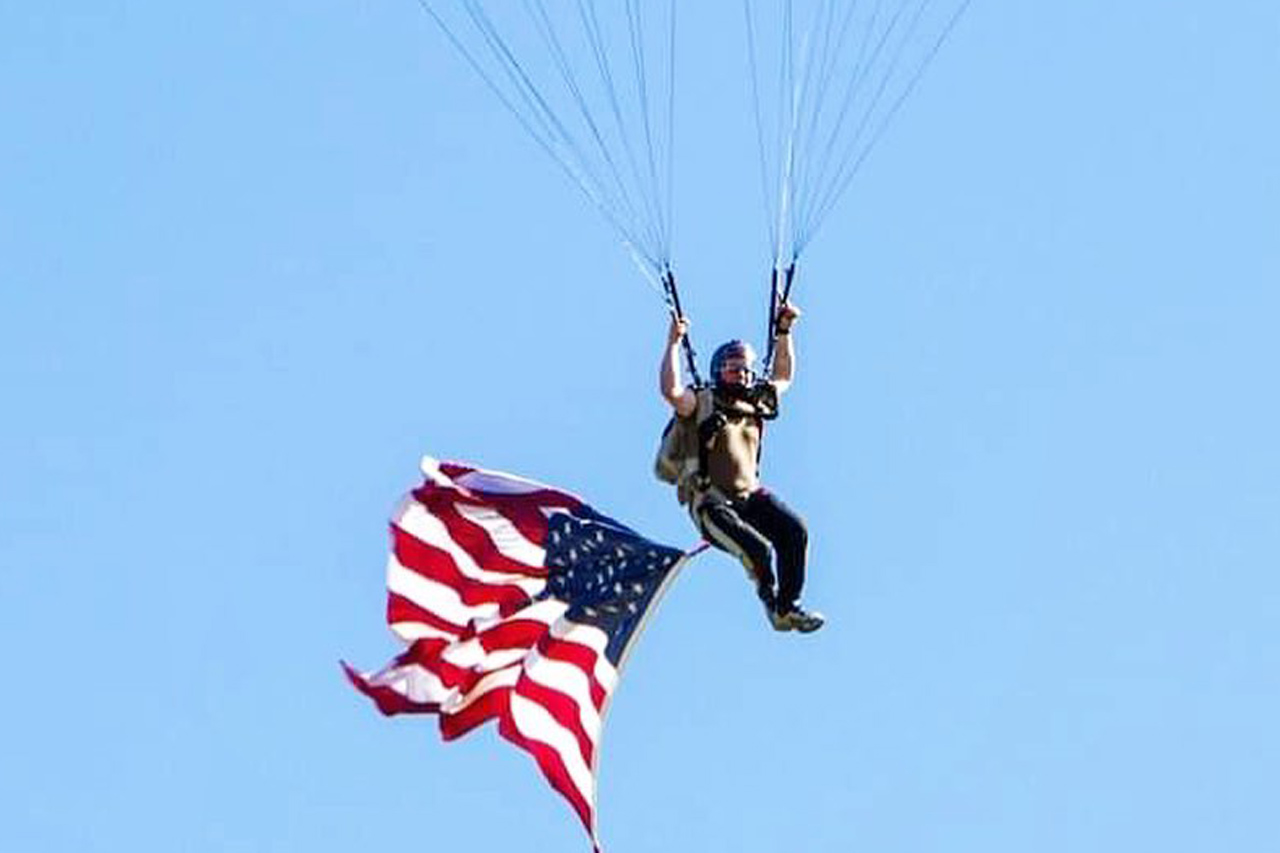 Experienced skydiver executing a demo jump with an American flag