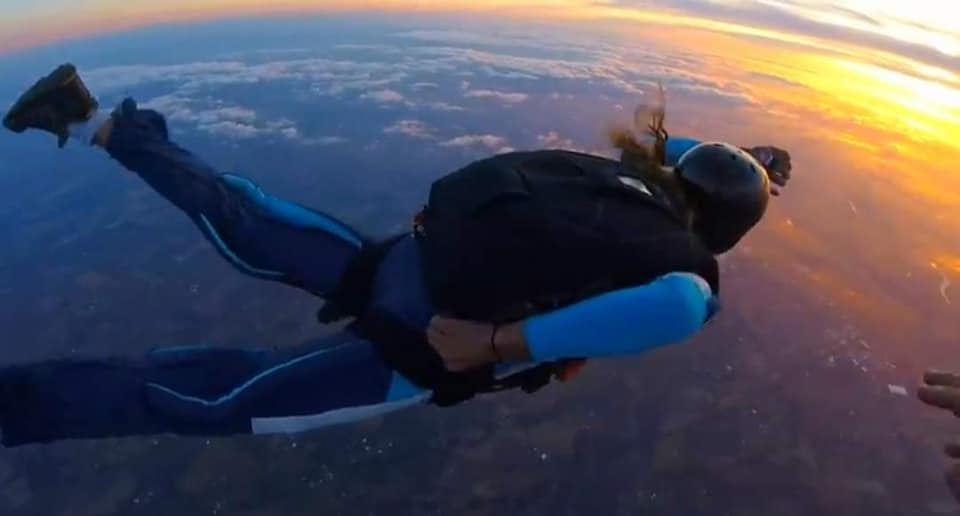 AFF student in freefall checking altimeter