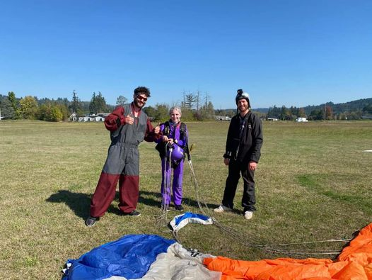 Student skydiver and instructors in landing area at PNW Skydiving near Portland, OR