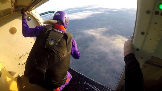Skydiver in door of aircraft preparing to jump out at PNW Skydiving