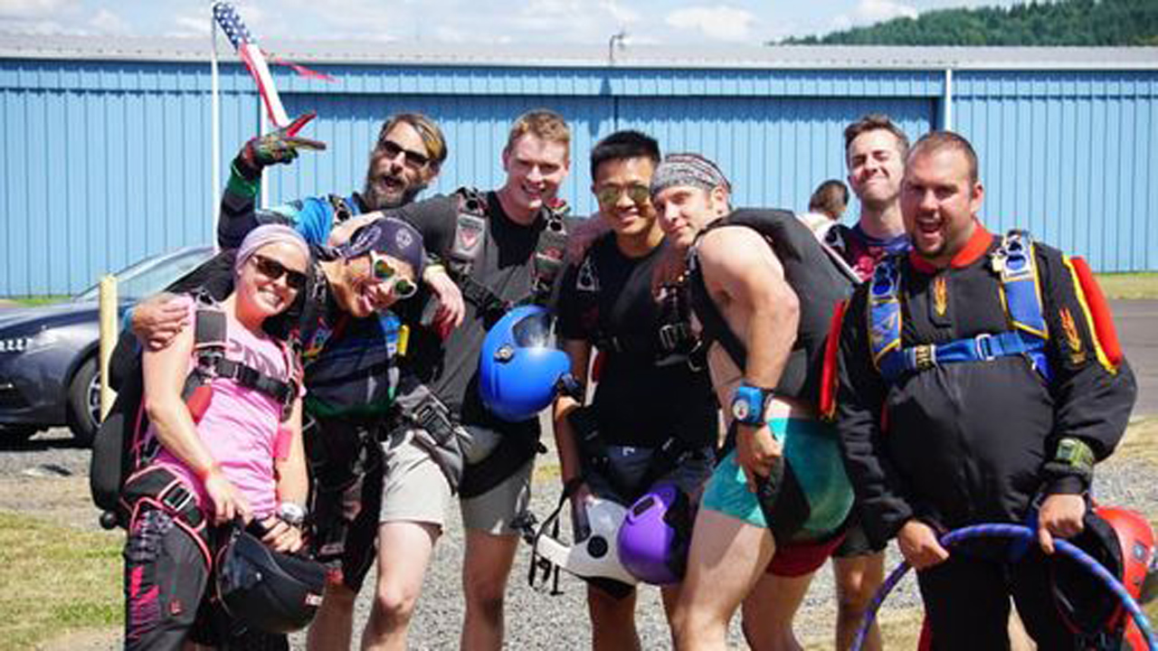 Fun jumpers at PNW Skydiving Center taking a group photo before jumping