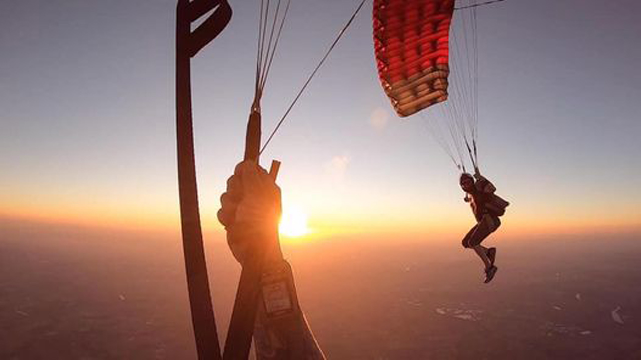 Experienced skydivers under canopy at sunset above PNW Skydiving in Oregon