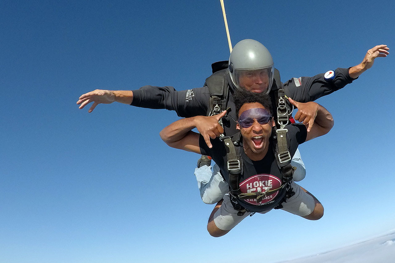 young man loving skydiving for the first time