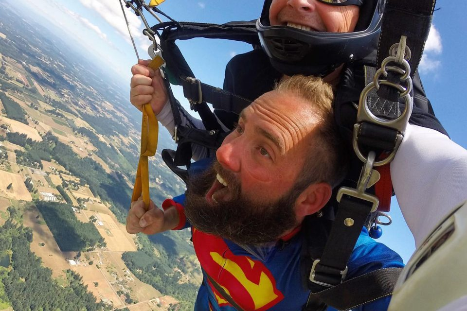 Man wearing superman shirt tandem skydiving at PNW Skydiving in Oregon