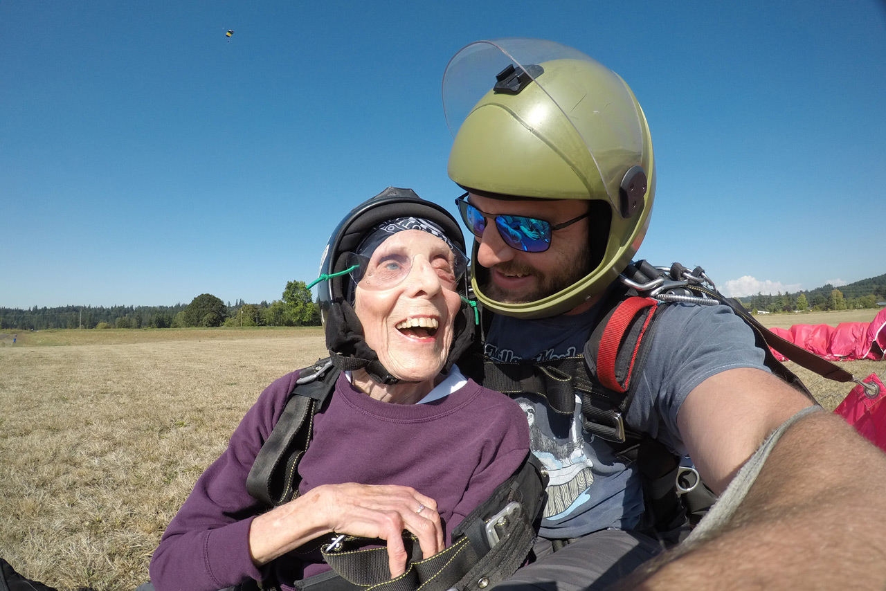 Elderly woman smiling after safely landing from a tandem skydive at PNW Skydiving Center in Oregon