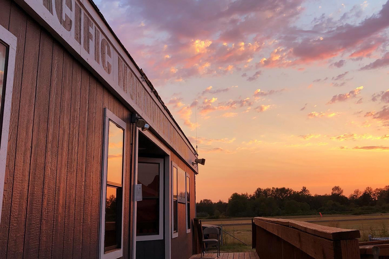 View of PNW Skydiving Center hangar at sunset