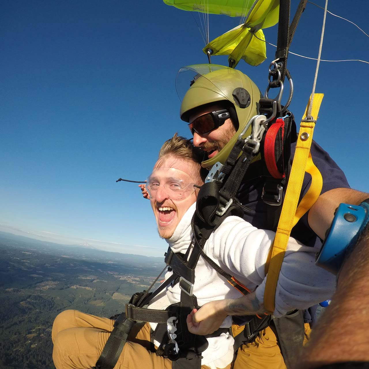 Young man with disability enjoying a canopy ride while tandem skydiving at PNW Skydiving near Portland, OR