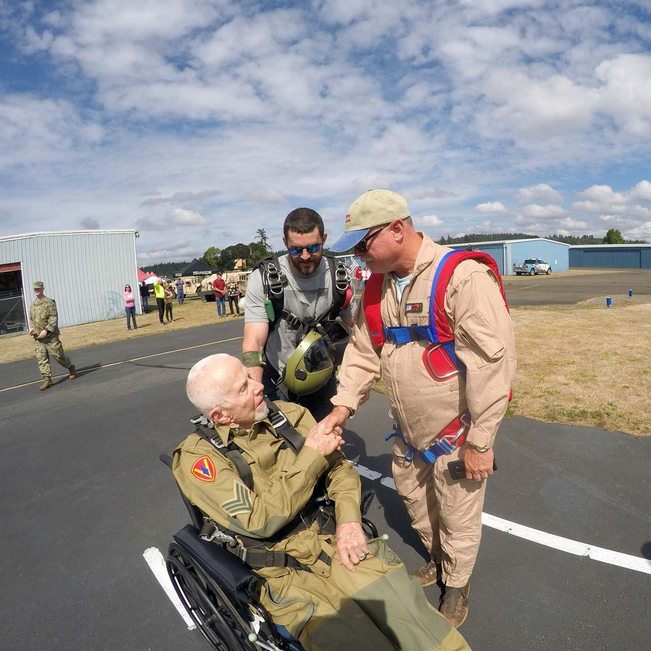Elderly veteran in wheelchair preparing to tandem skydive at PNW Skydiving near Portland, OR