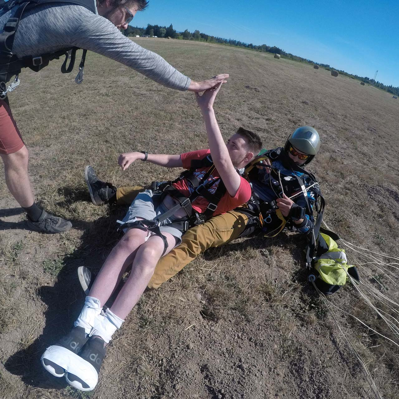 Young man with disability landing after a tandem skydive at PNW Skydiving Center in Oregon