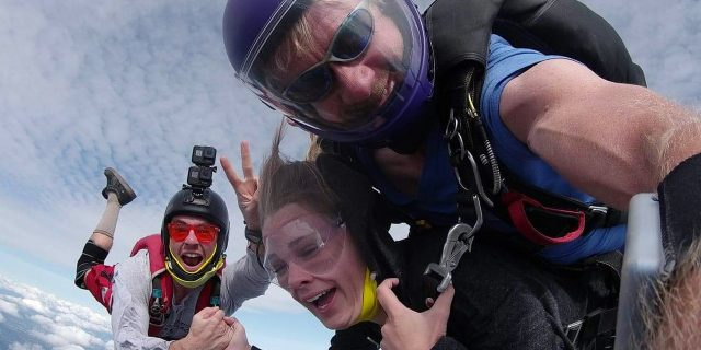 Tandem skydiving student in freefall with instructor and videographer skydiving in Oregon at PNW Skydiving
