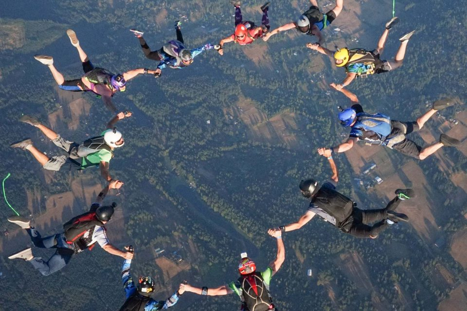 Licensed skydivers in circular freefall formation over PNW Skydiving near Portland, OR