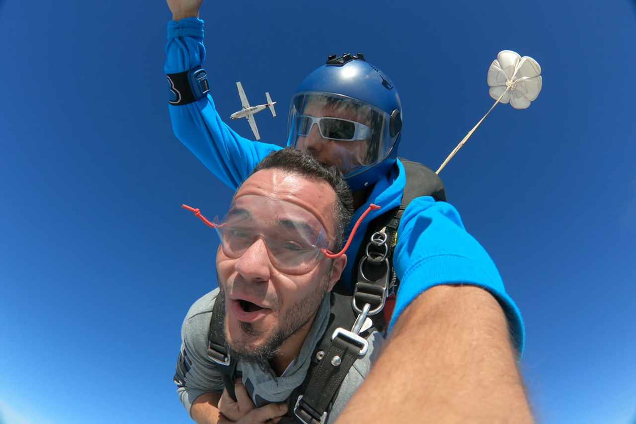 Close up photo of male tandem student smiling in freefall at PNW Skydiving in Oregon