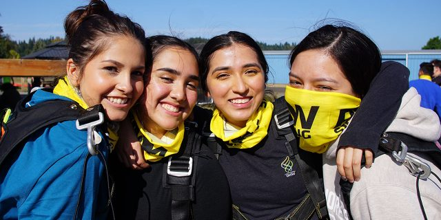 four girls embrace before skydiving at PNW Skydiving