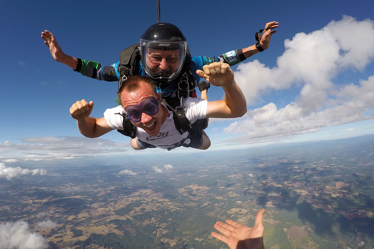 male tandem student smiles in freefall