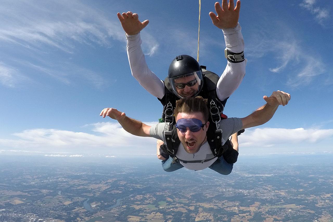 young man enjoying skydiving freefall